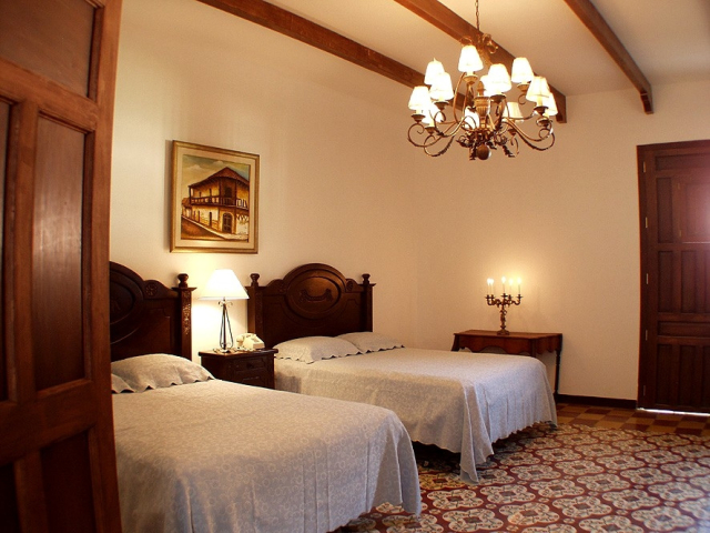 Room in colonial hotel in Granada